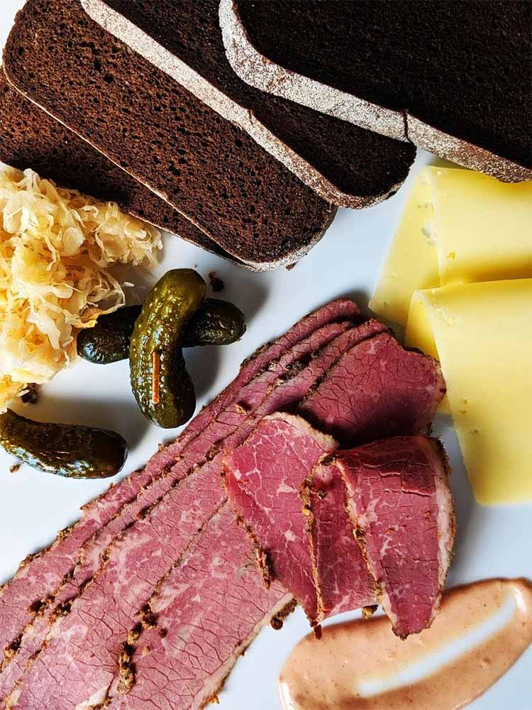 pastrami platter with rye, swiss cheese and sauerkraut