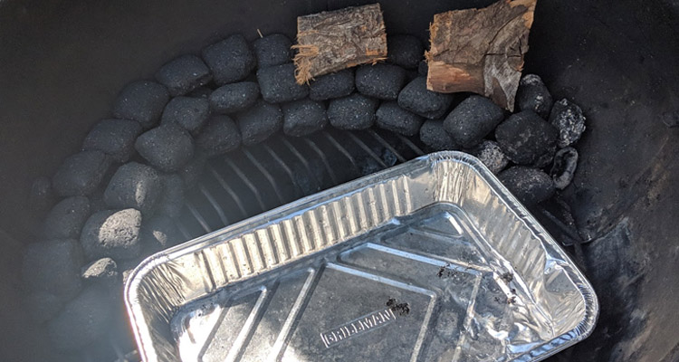 Charcoal stacked into a snake in weber kettle grill