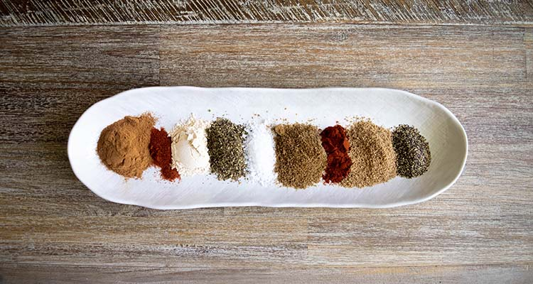 spices on a plate to make a rub for smoked or grilled lamb