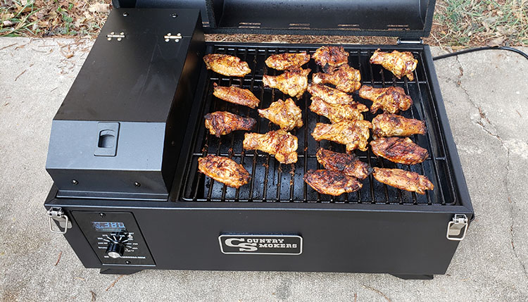 cooking chicken on Country Smokers The Traveler