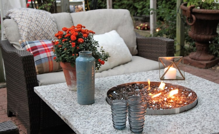 Outdoor seating arrangement around a fire pit table