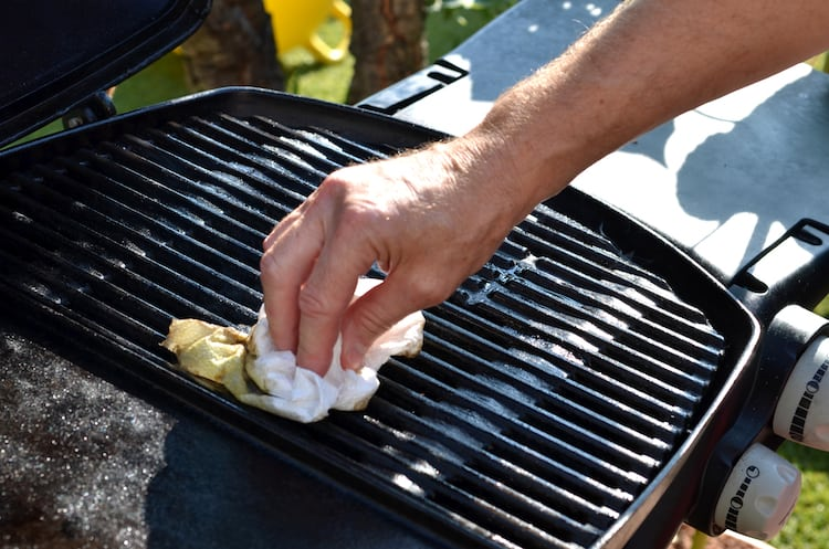 Cleaning an outdoor grill with a paper towel