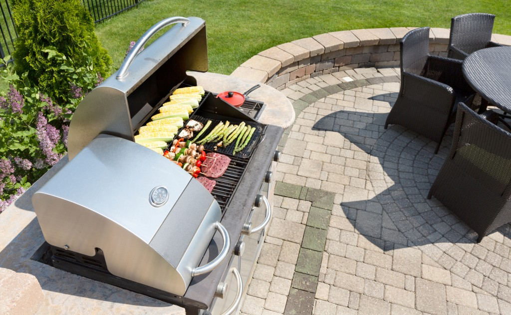 Outdoor high-end grill on a brick patio