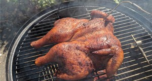 Chicken cooking on smoker with temperature probe