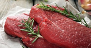lean cuts of beef with rosemary on a butcher paper