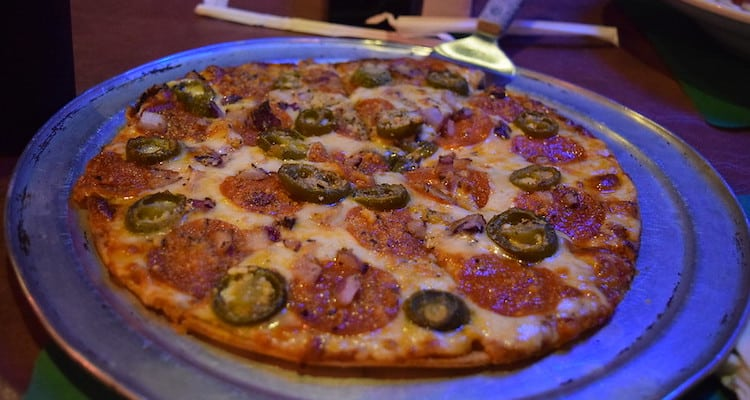 Whole pizza with pepperoni and jalapenos