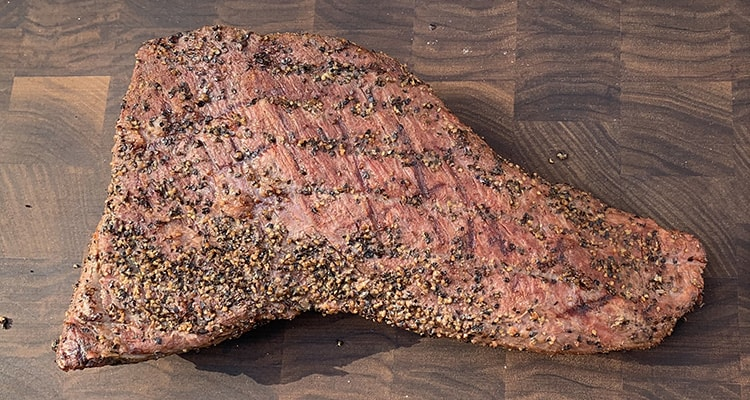 griller tri tip on a wooden board