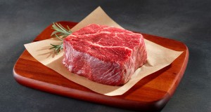 Top sirloin steak with herbs in a bowl