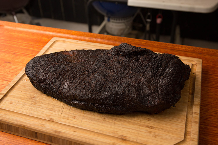 smoked brisket on a wooden board