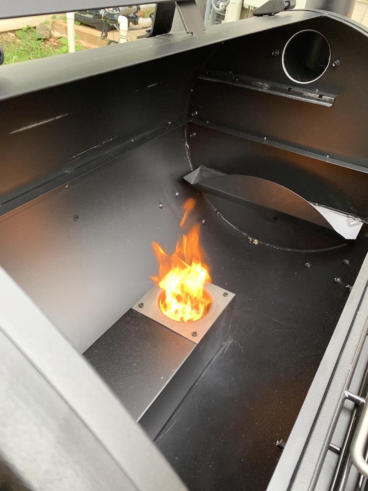 Fire inside the Pit Boss Sportsman 820 grill