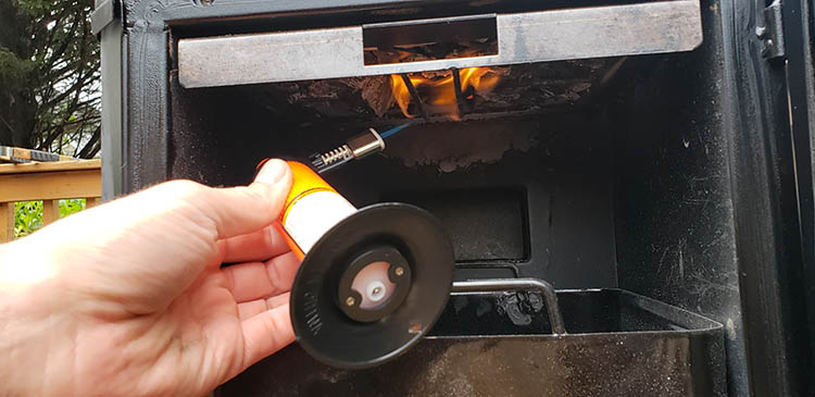 Igniting charcoal with butane torch