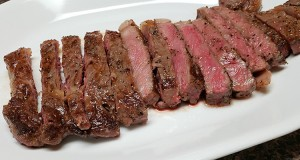 cooked steak on a white plate