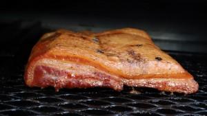 homemade bacon on smoker