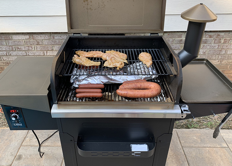 Different meats cooking on a Z Grills L6002B pellet grill