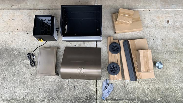 Unassembled parts of Z Grills L6002B pellet grill