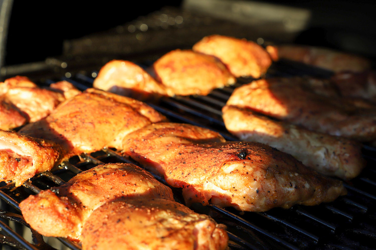 chicken thighs in a smoker