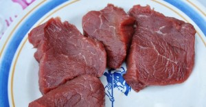 raw steak on the plate
