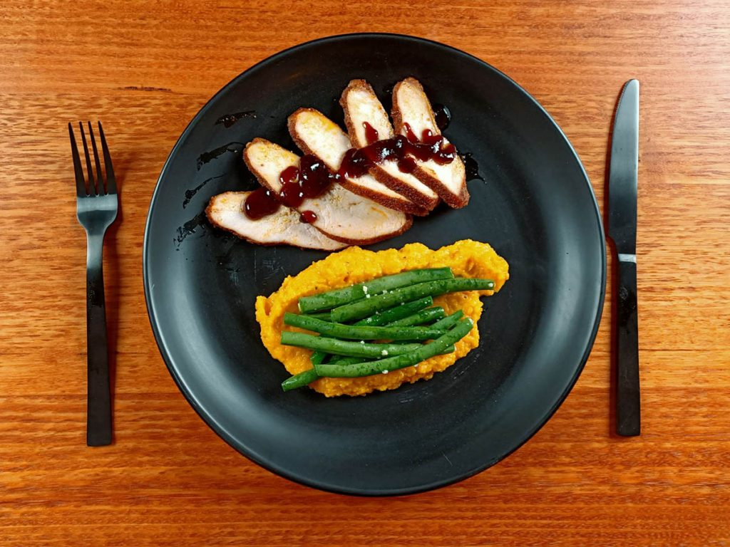 sliced bbq turkey breast with squash puree and green beans