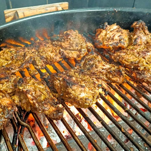 grilled jerk chicken on the grill