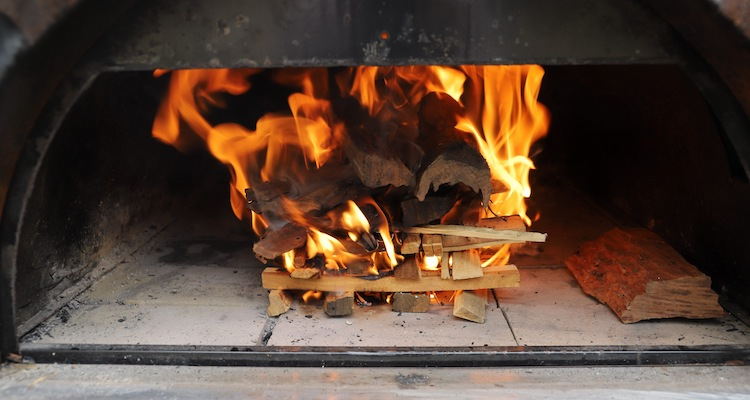 burning wood in a pizza oven