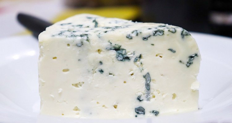 piece of blue cheese on a white plate