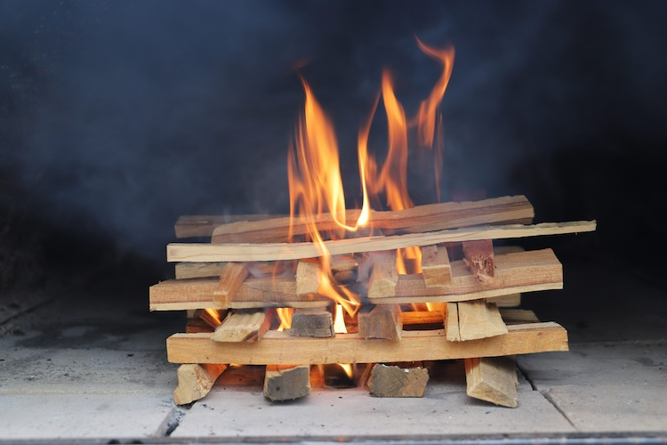 burning hardwood kindling in a pizza oven