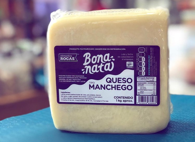 packaged Manchego on a table
