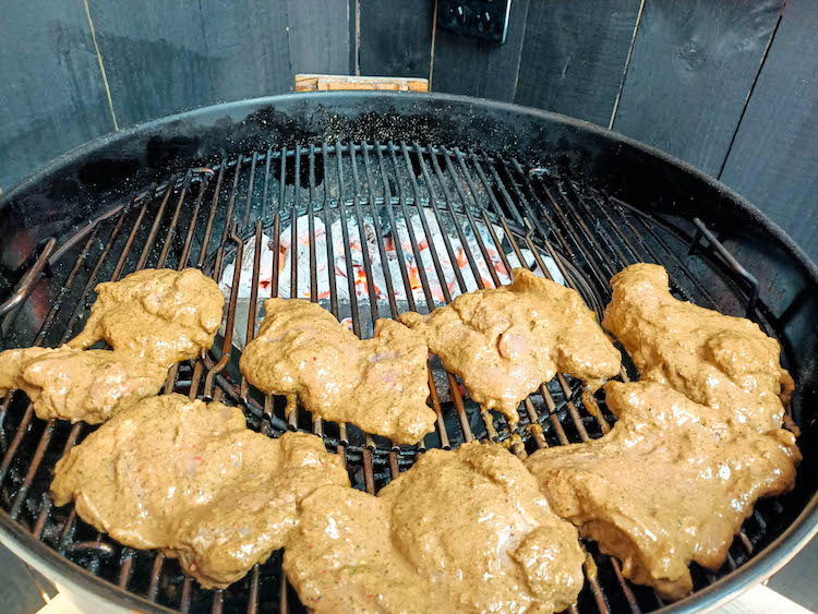 marinated jerk chicken thighs on the grill