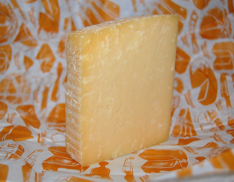 a piece of mature cheddar cheese