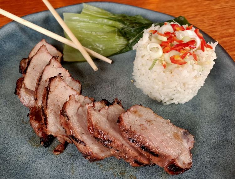 Char Siu pork with Jasmine rice and steamed greens on a plate