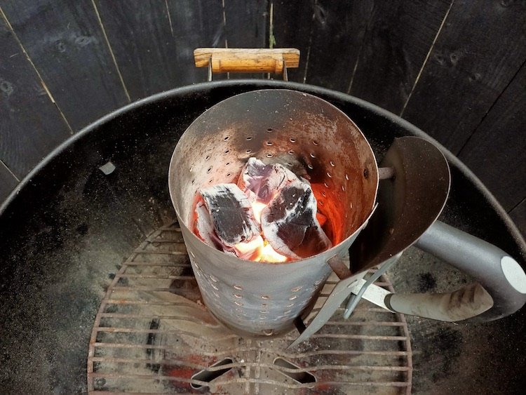 charcoal chimney with lit charcoal