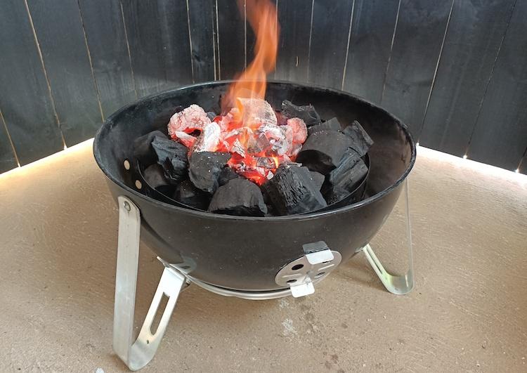 weber smokey mountain with lit charcoal