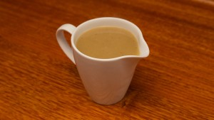 Homemade gravy in a pouring jug