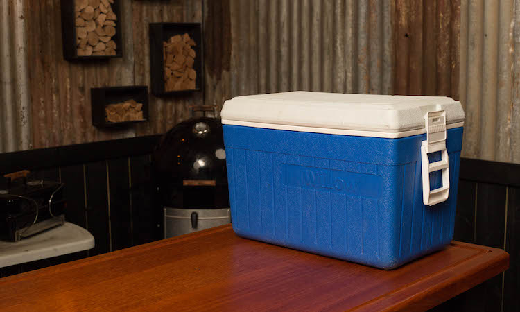 blue cooler on a wooden table