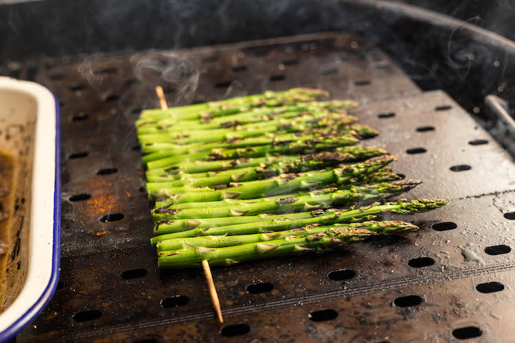 asparagus on a skewer on a grill