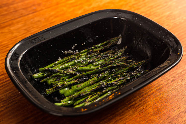 char grilled asparagus in a baking tray
