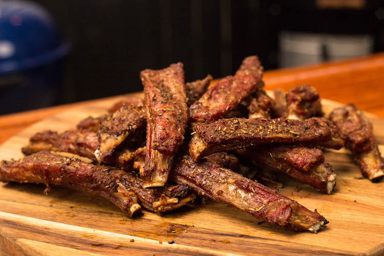 grilled lamb ribs on a wooden board
