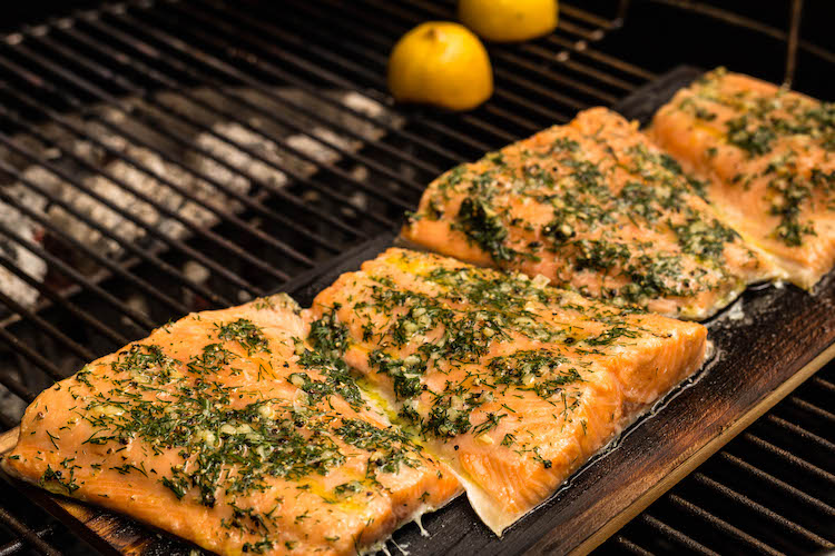cooked cedar planked salmon on a grill