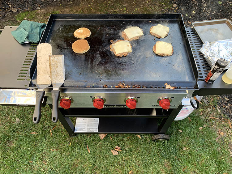 burgers cooking on a Camp Chef Flat Top Grill
