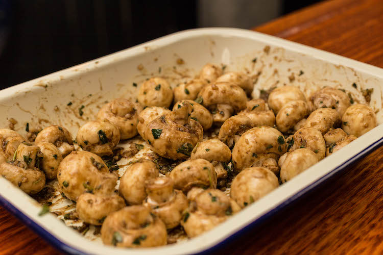white button mushrooms covered in butter garlic seasoning