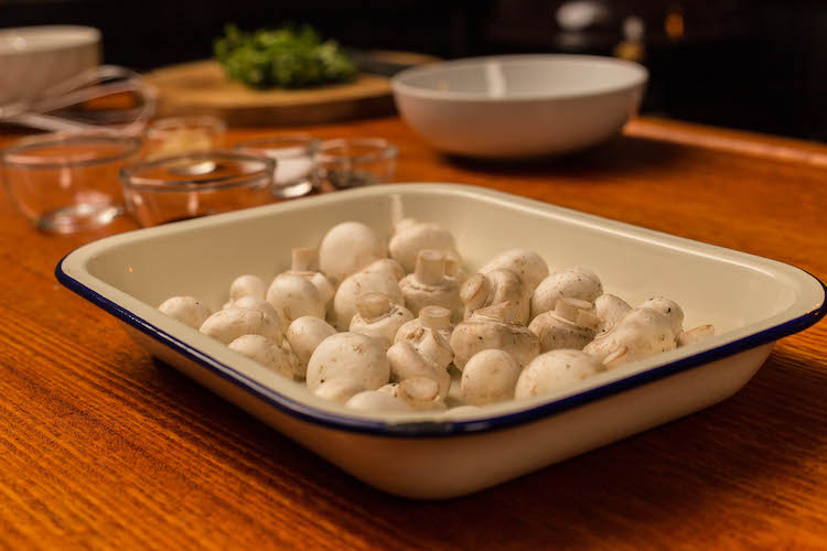 white button mushrooms in a baking tray
