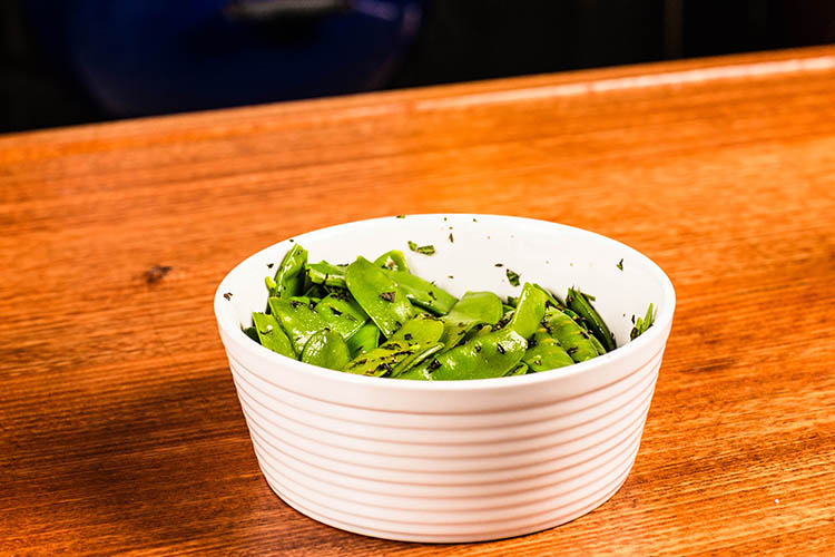 minted snow peas in a bowl