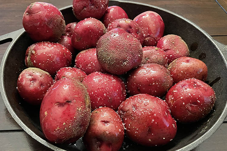 seasoned red potatoes on cast iron skillet