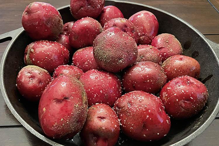 seasoned red potatoes on cast iron skillet