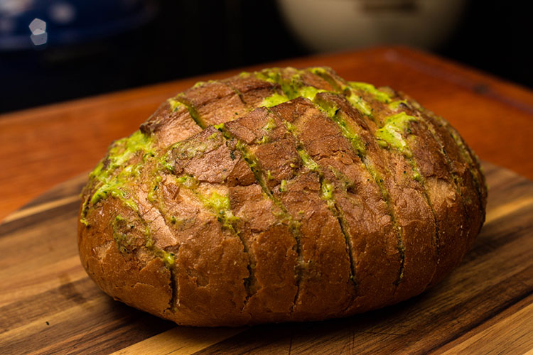cooked brazilian cilantro garlic bread on a wooden board