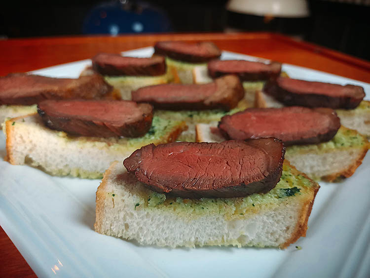 grilled picanha steaks on garlic bread