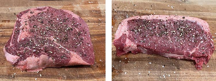 uncooked seasoned ribeye steak and NY strip steak on a wooden board