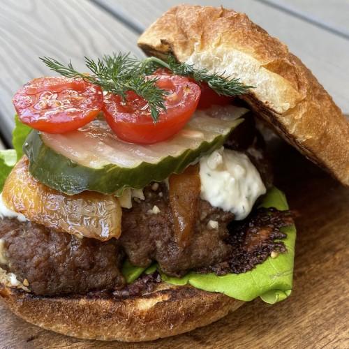 lamb burgers on a wooden board