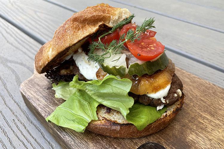 Mediterranean lamb burger on a wooden board