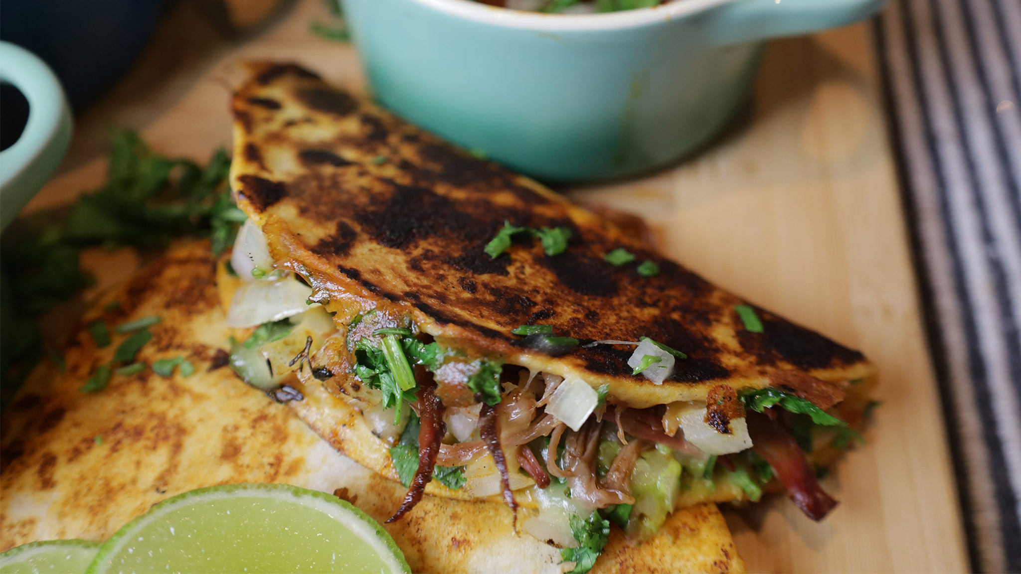 birria tacos on a wooden board
